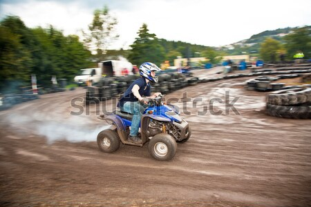 young boy is faszinated by quad driving and enjoyes is, his face Stock photo © meinzahn
