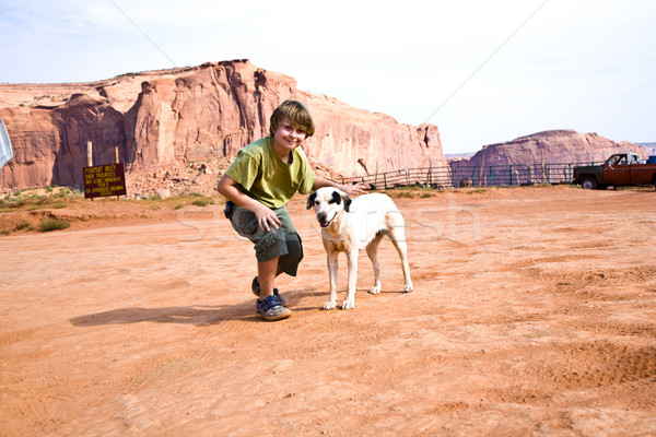 Monument Valley, boy strokes a beautiful lovely dog in the lands Stock photo © meinzahn