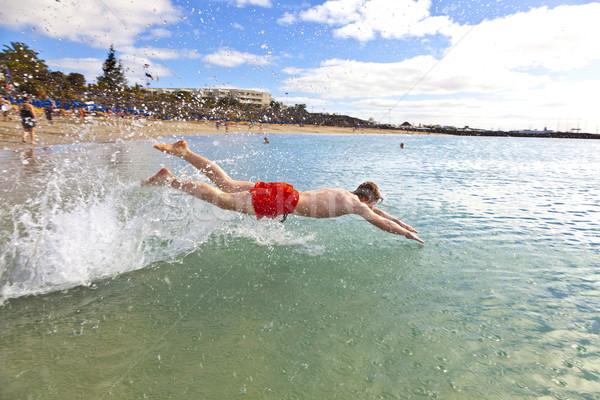 teen heads into the clear fresh ocean Stock photo © meinzahn