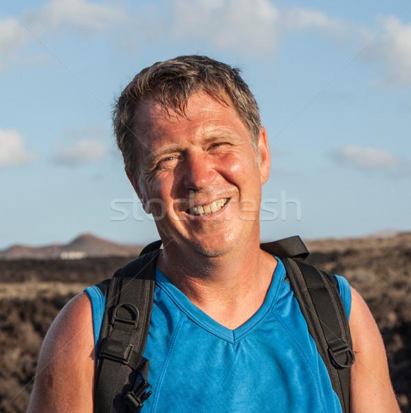 man on walking trail in volcanic area Stock photo © meinzahn