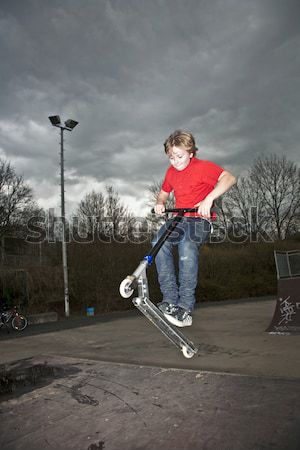 Boy riding a scooter and going airborne on a scooter park Stock photo © meinzahn