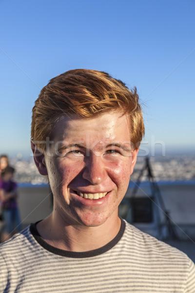 portrait of handsome boy with red hair under blue sky Stock photo © meinzahn