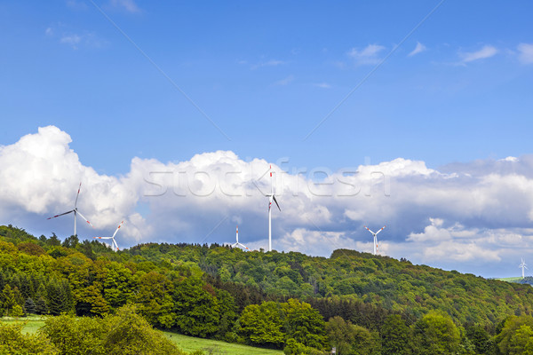 wind turbine generating electricity on blue sky  Stock photo © meinzahn