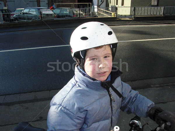 cute boy in anorak on bike with dirt in the face from riding in  Stock photo © meinzahn