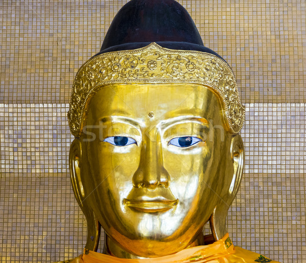 Kakusandha buddha image covered with foilgold Stock photo © meinzahn