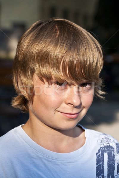 young boy looking confident and smiles Stock photo © meinzahn