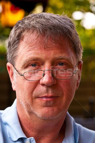 Portré férfi olvasószemüveg mosolyog mosoly arc Stock fotó © meinzahn