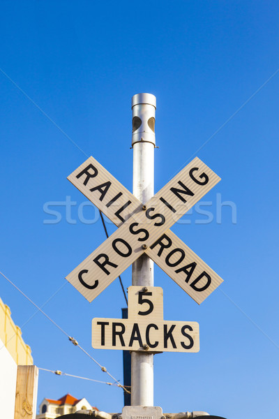 railroad crossing sign with blue sky Stock photo © meinzahn