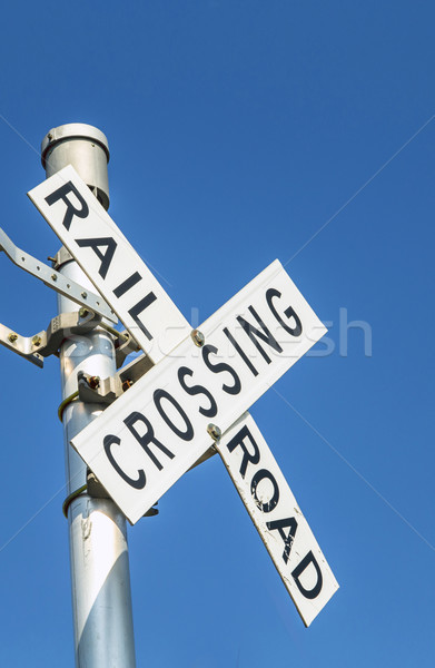 Railroad warning crossing sign under blue sky Stock photo © meinzahn