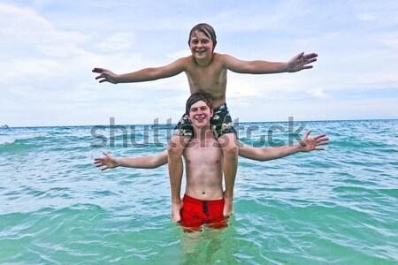 Erkek güzel deniz oynama plaj Stok fotoğraf © meinzahn