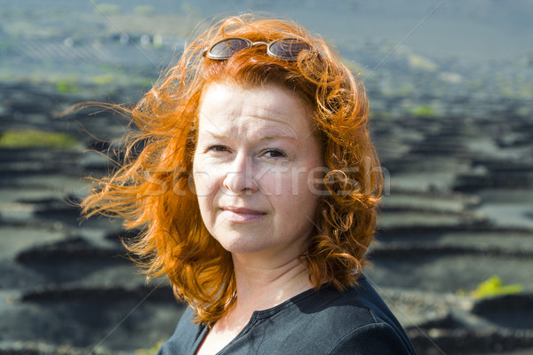 women with red hair is looking intensively Stock photo © meinzahn
