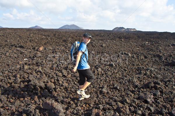 boy on walking trail in volcanic area in Lanzarote Stock photo © meinzahn