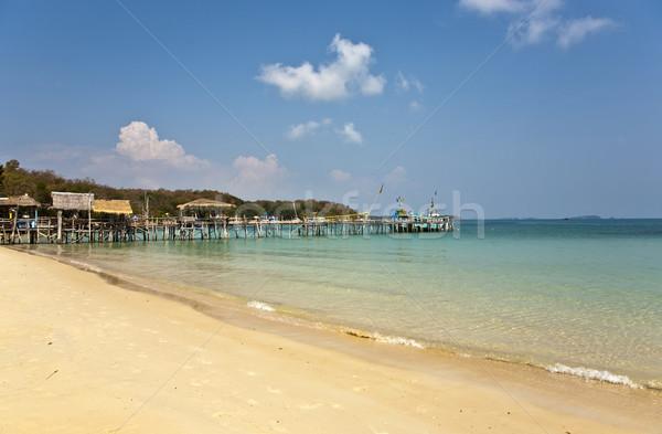 beautiful beach with wooden pier in bay  Stock photo © meinzahn