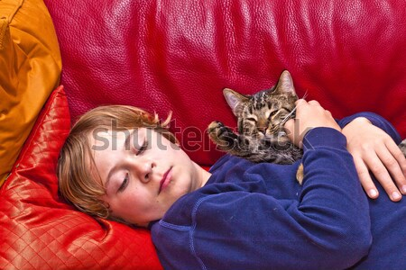young boy is hugging with his cat  Stock photo © meinzahn