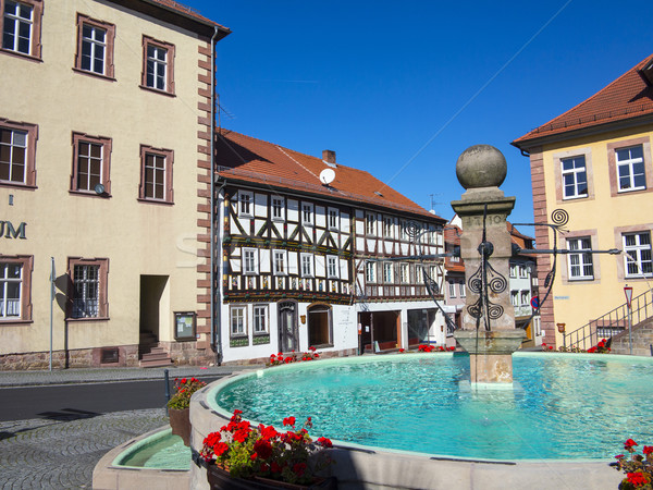 market place wit fountain and  half timbered houses in fairy tal Stock photo © meinzahn