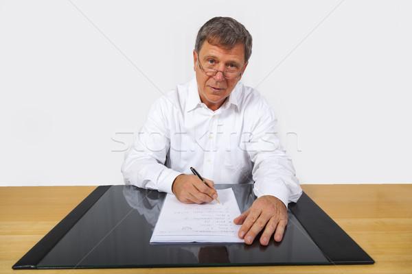 business man sitting at his desk Stock photo © meinzahn