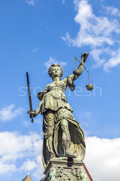 Justitia (Lady Justice) sculpture on the Roemerberg square in Fr Stock photo © meinzahn