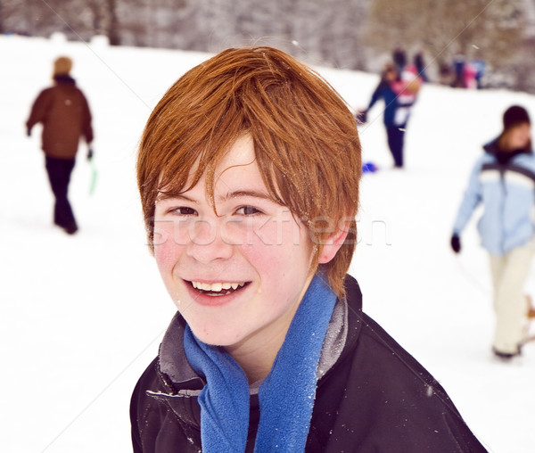 boy with red hair enjoying   the snow  Stock photo © meinzahn