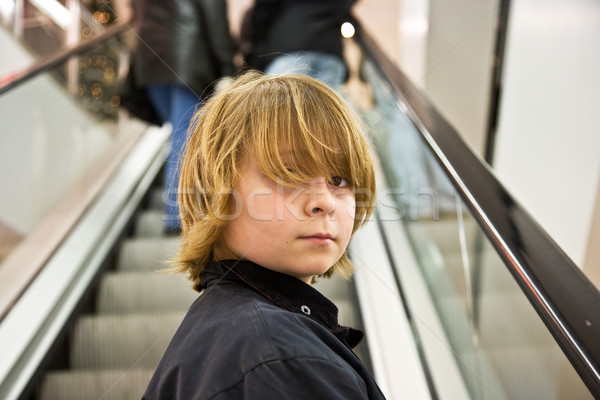 child is smiling self confident on a stairway in a shopping mall Stock photo © meinzahn