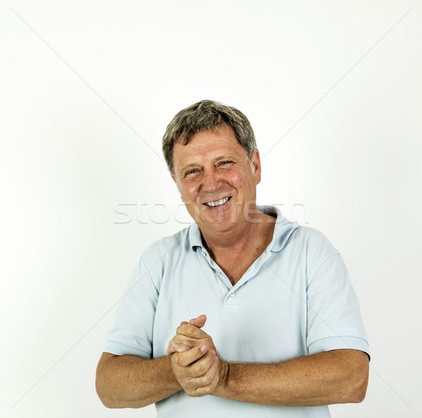 Jóképű mosolyog férfi kék szabadidő pólóing Stock fotó © meinzahn