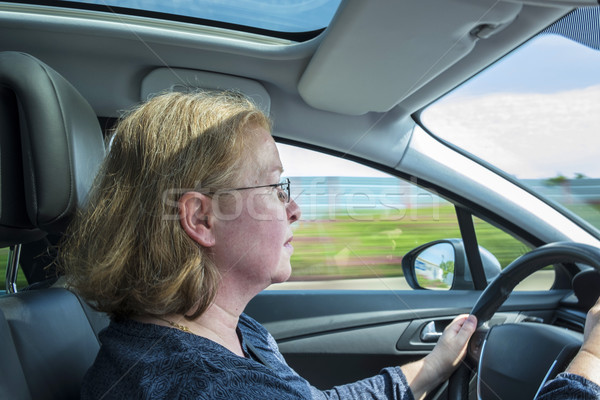 woman drives the car concentrated on a german highway Stock photo © meinzahn