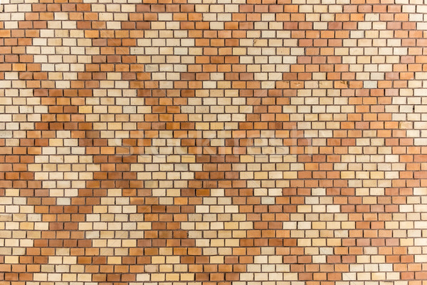 brick wall decorated with geometric motifs Stock photo © meinzahn