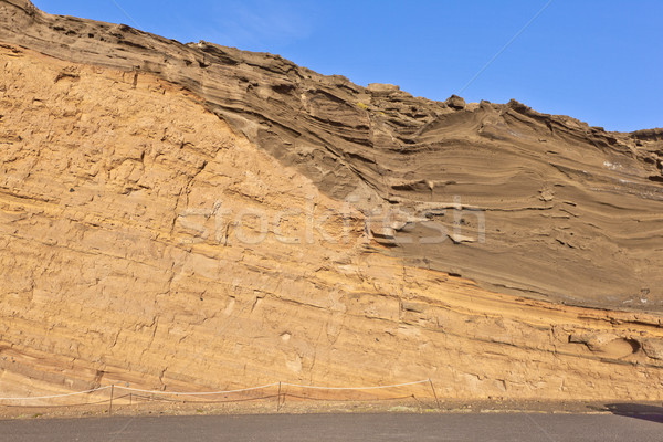 volcanic stone formation with blue sky at el Golfo, Lanzarote Stock photo © meinzahn