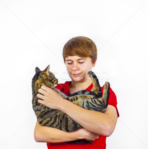 boy hugging with his cute cat Stock photo © meinzahn