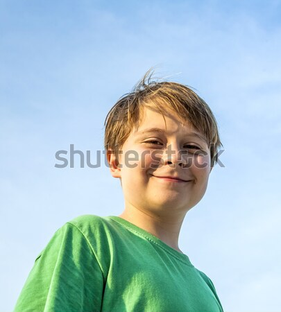 happy smiling young boy with background blue sky irises up his a Stock photo © meinzahn