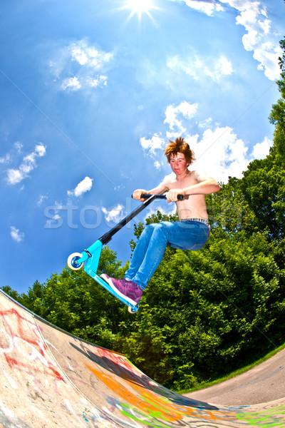 Fiatal srác moped égbolt gyerekek nap test Stock fotó © meinzahn