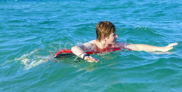 Erkek yüzmek halka eğlence okyanus Stok fotoğraf © meinzahn