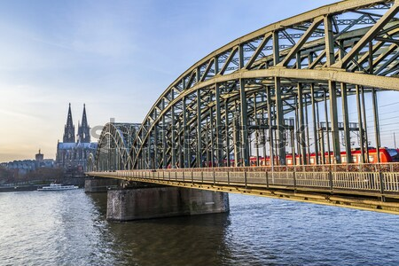 Cathedral of Cologne with iron arcs of Hohenzollern bridge, Colo Stock photo © meinzahn