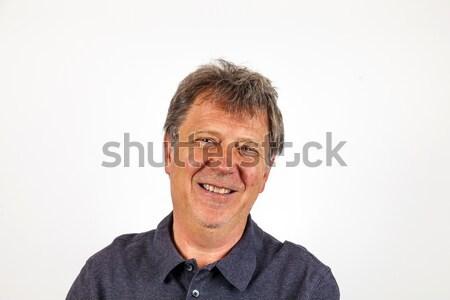 Portré jóképű férfi olvasószemüveg boldog modell háttér Stock fotó © meinzahn