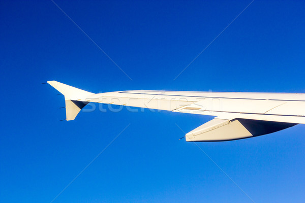Aircraft wing some component of plane on during flying high abov Stock photo © meinzahn