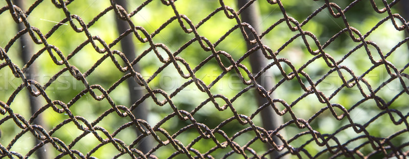 Detail of an old rusting chain fence  Stock photo © meinzahn