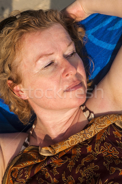 beautiful woman with red hair is enyoing the sun in a canvas cha Stock photo © meinzahn