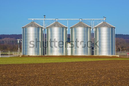 acres with snow in winter with silo in beautiful light and struc Stock photo © meinzahn