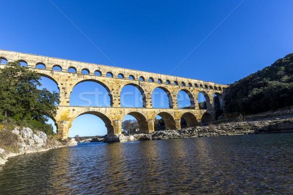 Pont du Gard is an old Roman aqueduct near Nimes  Stock photo © meinzahn