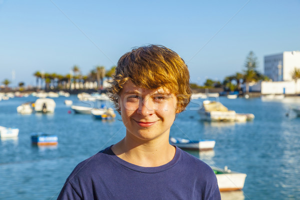 handsome happy smiling boy with the famous charco de San Gines i Stock photo © meinzahn