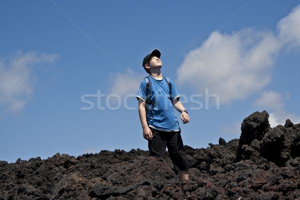 boy on walking trail thru volcanic area Stock photo © meinzahn