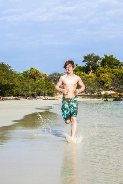 Correr playa tropical traje de baño ejecutando Foto stock © meinzahn