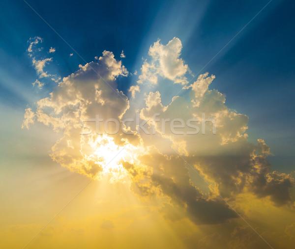 Naplemente nap sugarak égbolt felhők absztrakt Stock fotó © meinzahn