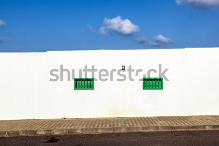 facade uf mediterranean house with closed shutterblinds Stock photo © meinzahn