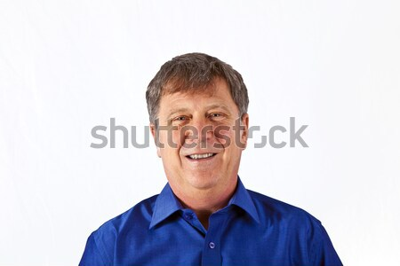 attractive man dressed casually in studio isolated on white Stock photo © meinzahn