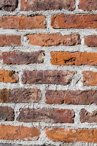 Weathered brick stone wall Stock photo © meinzahn