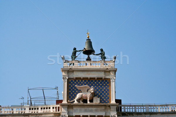 famous clocktower of venice with the old city flag and the lion, Stock photo © meinzahn