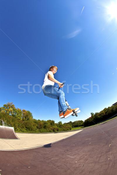 Fiú ugrik moped gyerekek út sport Stock fotó © meinzahn