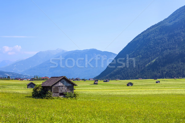 huts for storing materials and hay on a green meadow in the aust Stock photo © meinzahn