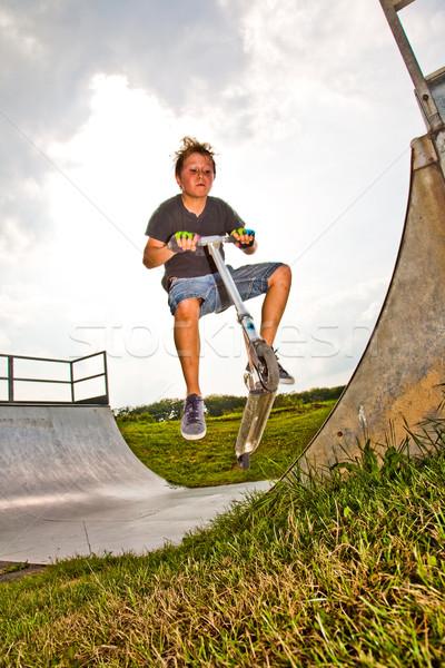 Fiú moped gyermek jókedv ugrik kéz Stock fotó © meinzahn