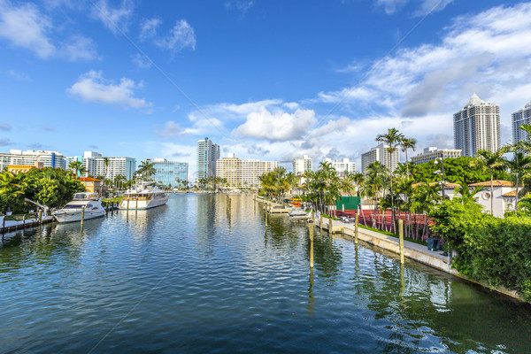 luxury houses at the canal in Miami Beach with boats Stock photo © meinzahn